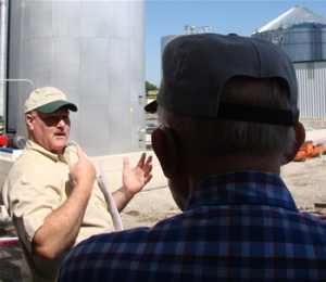 Producer's Choice board member Larry McDonald (left) leads a tour through the plant as farmer Leroy Taylor, of Palmyra, watches on. Taylor owns a farm in Palmyra and invested some money in the $17.5 million biodiesel production facility.