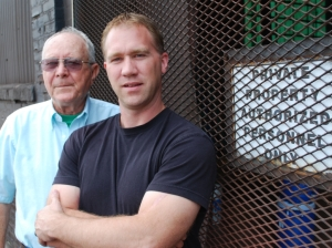 Andy Lowrey (left) and son Eric own Trojan Ironworks on North 25th Street. They make everything from stair rails to steel beams. Paul McKee wants to buy their building, and plans to help pay for this and other small businesses to relocate. (Photo: Matt Sepic/ St. Louis Public Radio)