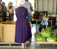 An Amish woman and her son at an auction.