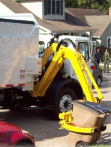An automated trash truck collects a recepticle. Cape Girardeau city officials are contemplating the purchase of six automated trash trucks and 22,000 containers.