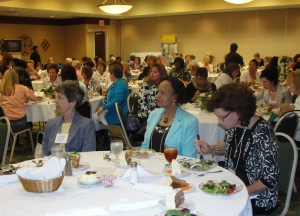 Female business leaders listen to U.S. Sen. Kit Bond speak at a recent Women's Business Conference in Columbia.